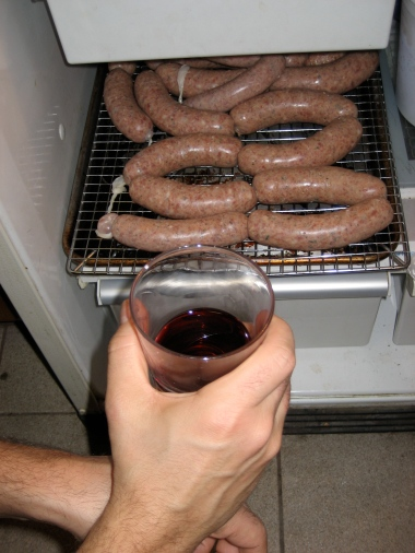 Staged Shot - Theo Peck drinks red wine while making duck sausage - how edgy